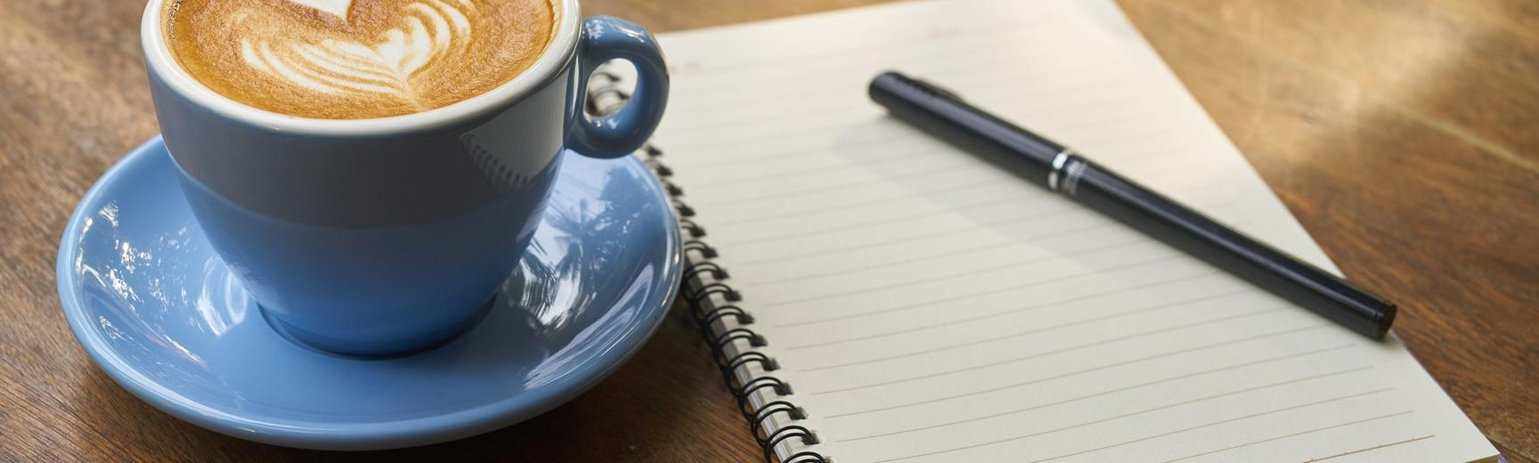 Writing notes and drinking coffee